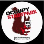 Occupy Stadtpark Logo mit dem Stadtpark Hansi, der eine Guy Fawkes Maske vor sein Gesicht hält